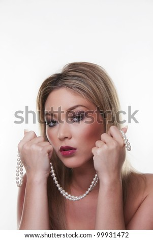 heand of beautiful female model holding a pearl necklace