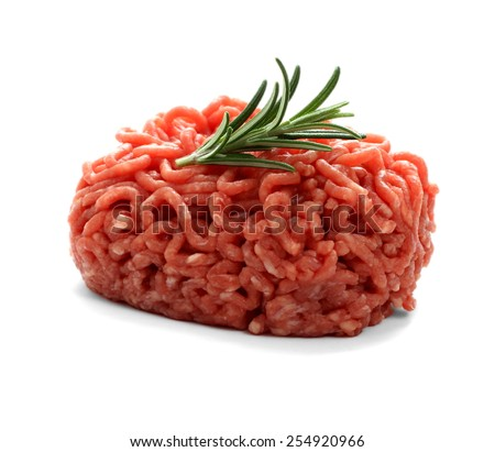 heap beef minced meat with rosemary, isolated - stock photo