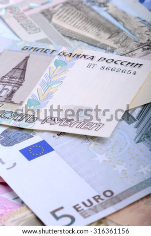 Heap from dollars, the Russian rubles and euro - stock photo