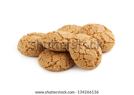 heap of almond cookies on white background - stock photo