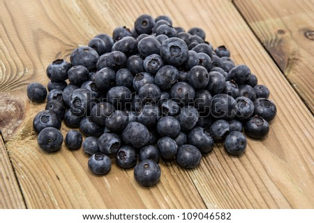 Heap of Blueberries on a wooden background