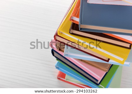 Heap of books on table close up - stock photo
