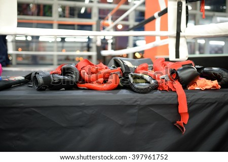 Heap of boxing gloves and bandage after training - stock photo