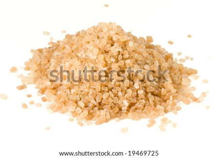 Heap of brown cane sugar isolated on white, macro lens shot - stock photo