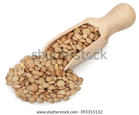 heap of brown lentils in a wooden scoop  isolated on white background close-up - stock photo