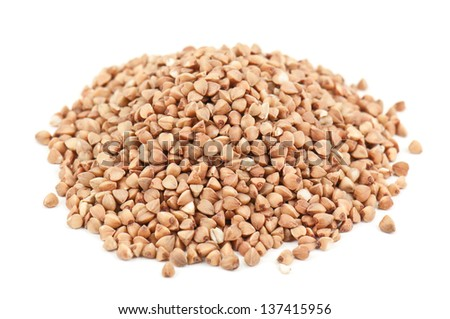 heap of buckwheat on white