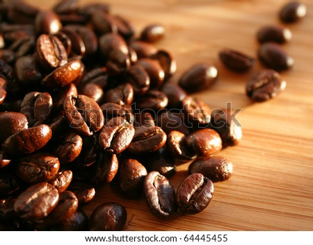 Heap of burnt brown arabica coffee beans - stock photo