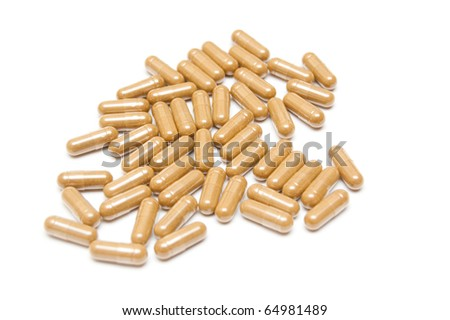 heap of capsules isolated on white