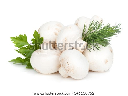 Heap of champignon mushrooms with herbs. Isolated on white background - stock photo