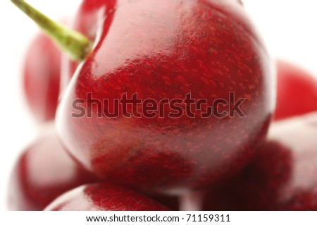 Heap of cherries close-up on white background. - stock photo