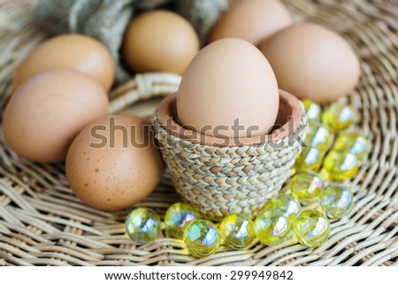 heap of chicken eggs lay on basketwork, easter eggs