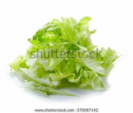Heap of chopped iceberg lettuce isolated on white background - stock photo