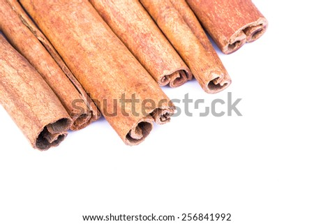 Heap of cinnamon sticks on a white background top view - stock photo