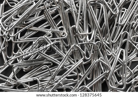 Heap of clips - abstract stationery background