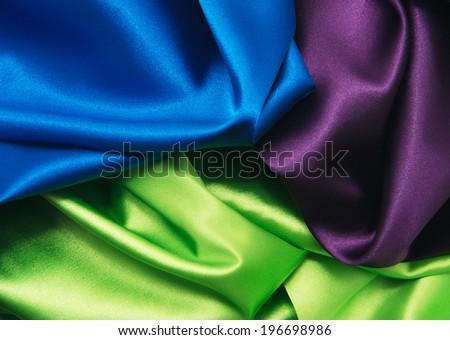 heap of cloth fabrics, close up - stock photo