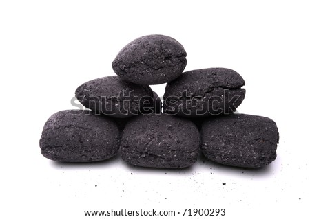 heap of coal briquette for BBQ isolated on white - stock photo