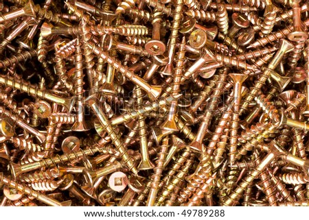 Heap of coated steel deck screws close up