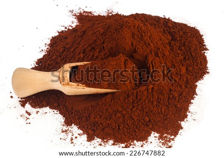 Heap of cocoa powder with wooden scoop isolated on the white background  - stock photo