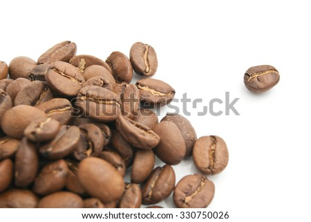 heap of coffee beans closeup on white