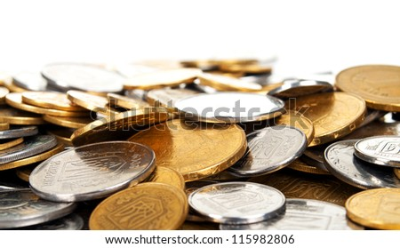 Heap of coins on white background - stock photo