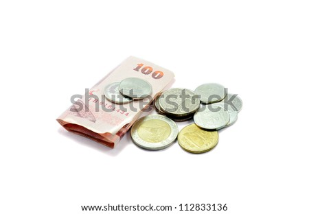 Heap of coins with bank on white background