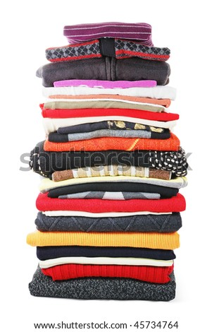 Heap of colored clothes isolated on white background - stock photo