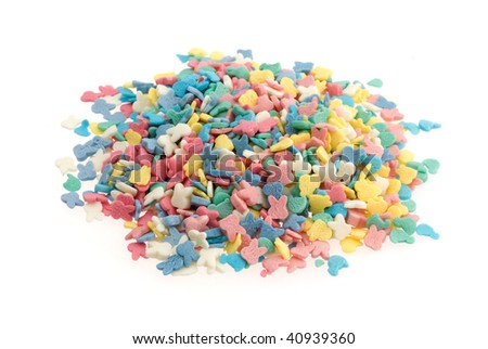 heap of colorful sweets isolated on white background