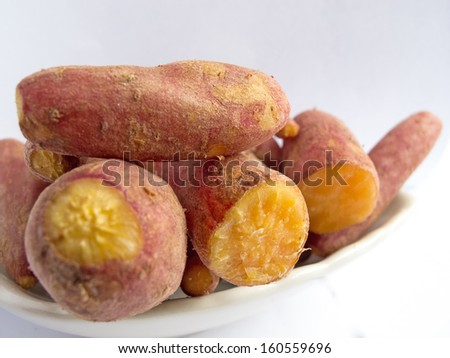 Heap of cooked sweet potatoes on plate. - stock photo