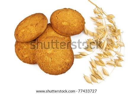Heap of cookies oatmeal with stems of oats is isolated on a white background