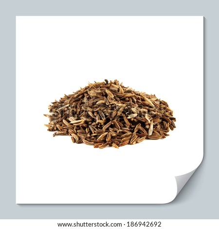 Heap of cumin seeds isolated on white background - stock photo
