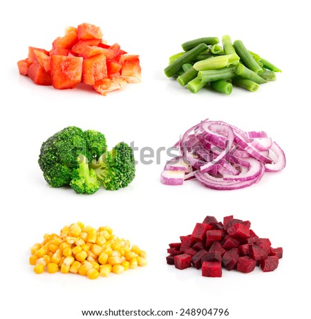 Heap of cut pepper, onion, broccoli and other vegetables isolated on white