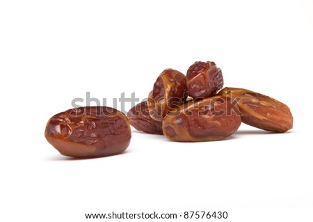 Heap of date fruits from low perspective on white background. - stock photo