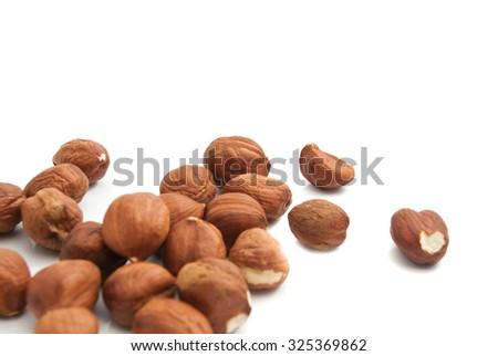 heap of delicious hazelnuts on white background - stock photo