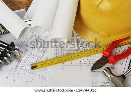 heap of design and project drawings on table background. - stock photo