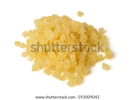 Heap of diced cubes of pineapple isolated on white. Candied fruits