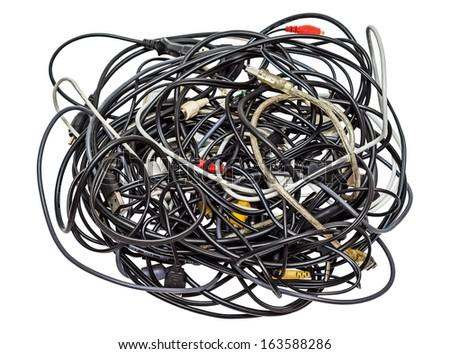 Heap of different computer cables and plugs isolated on white background - stock photo