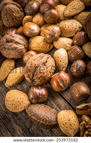 heap of different kinds of nuts in shell - stock photo