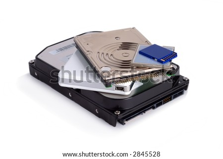 Heap of different storage devices isolated over white background - stock photo