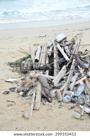 heap of dirty garbage on beach - stock photo