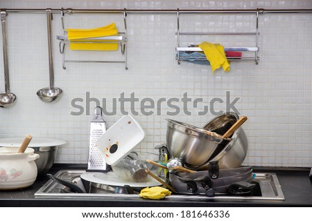 Heap of dirty utensil on the kitchen - stock photo