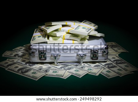 Heap of dollars on the table - stock photo