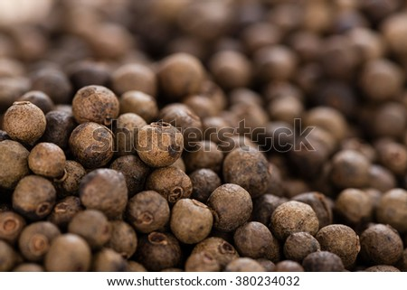Heap of dried Allspice for use as background image or as texture