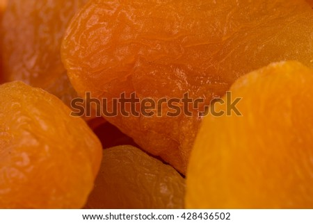 Heap of dried apricots macro  close-up shot