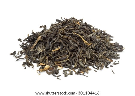 Heap of dried green tea on white background - stock photo