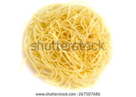 Heap of dry vermicelli, ingredient italian food isolated on white - stock photo