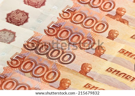 Heap of five thousand russian rubles banknotes as background - stock photo