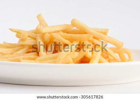 Heap of French fries from fast food shop on white backgrounds  - stock photo