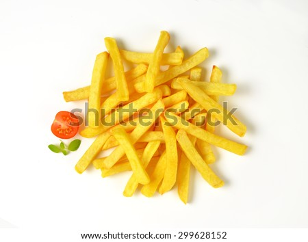 heap of french fries on white background - stock photo