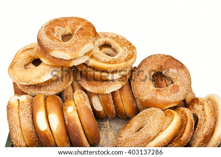 heap of fresh big bagels on a white background - stock photo