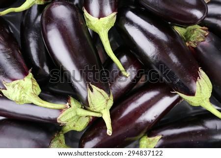 Heap of fresh eggplants close up - stock photo
